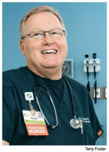 Nurse educating others on hemodynamic monitoring