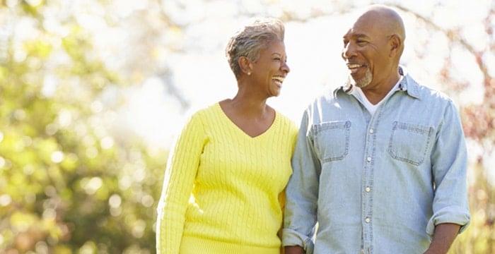 Older couple walking outside happily