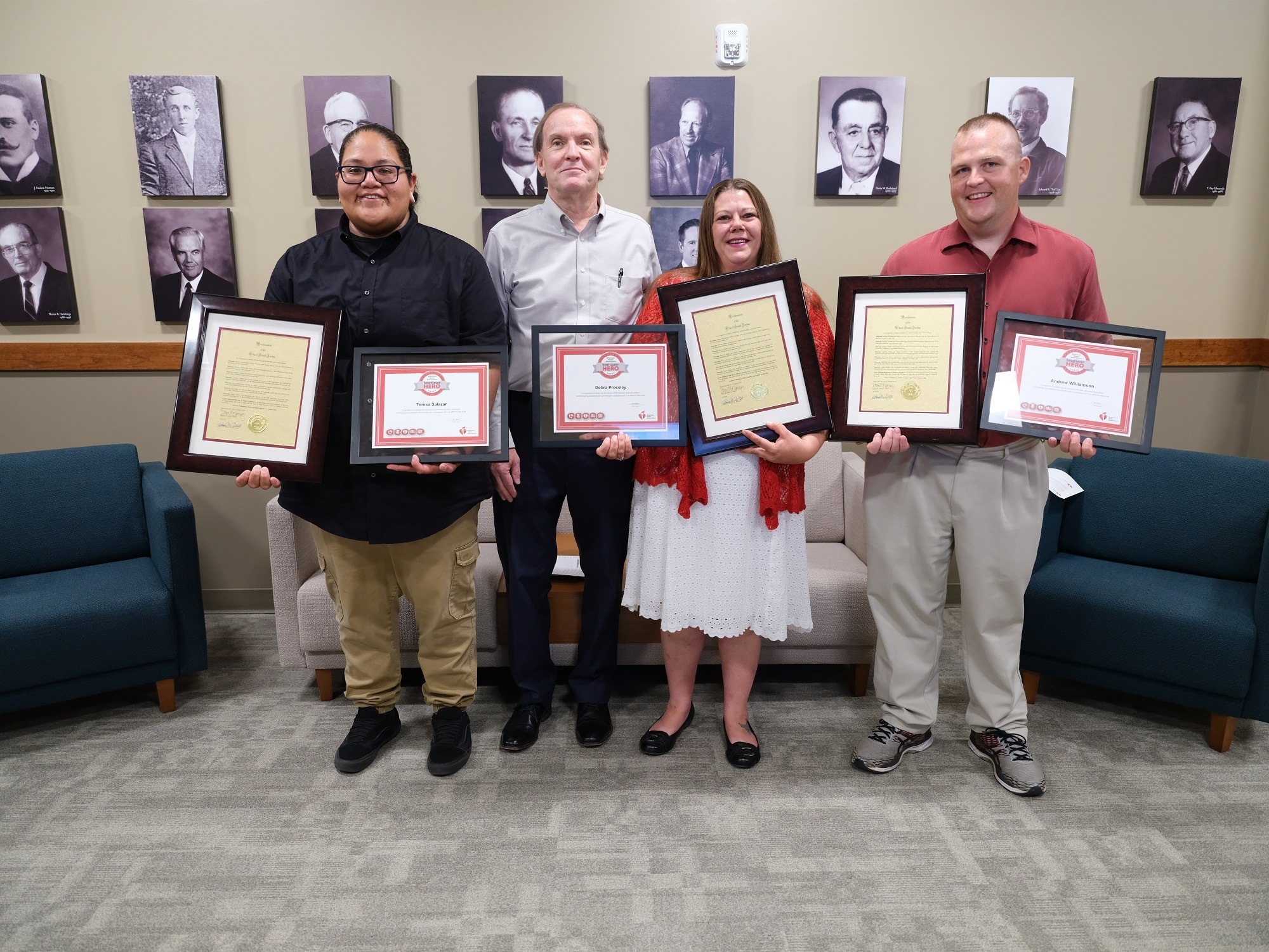 Merit Employees with Awards - Recognized for Saving Co-Worker's Life