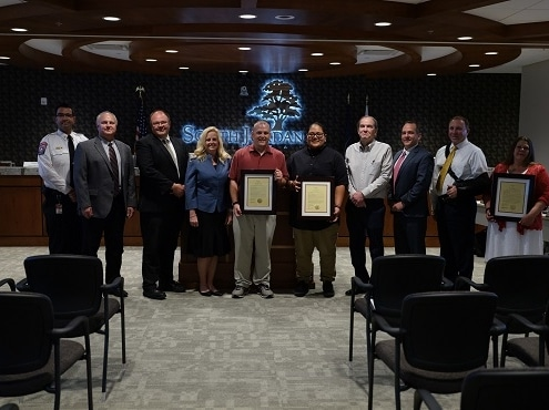 Merit Employees Receive Award for Saving CoWorker's Life