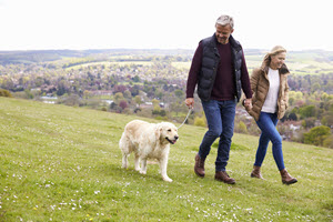 Man Enjoying Walk with Dog & Partner